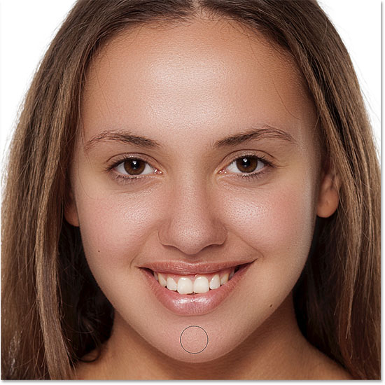 Smoothing the skin in the lower areas of the woman's face in Photoshop