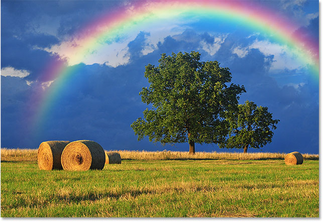 The rainbow now appears only in the sky.
